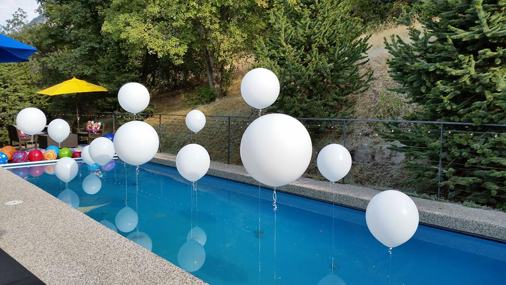 White pool balloons