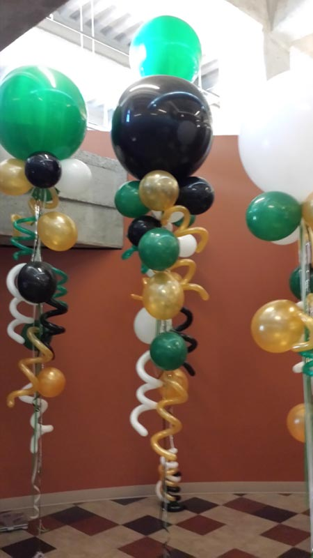 Green, black and gold balloon kites with twists